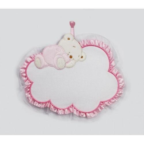 Teddy bear sleeping on a cloud